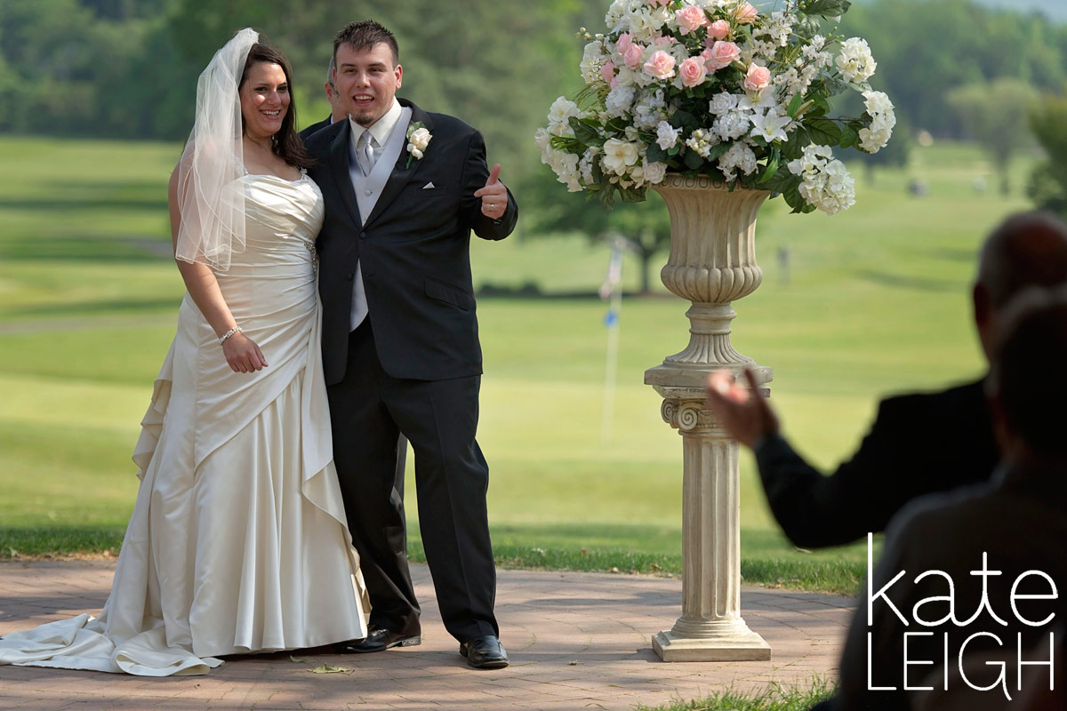 Groom and Dad giving thumbs up after wedding ceremony ends