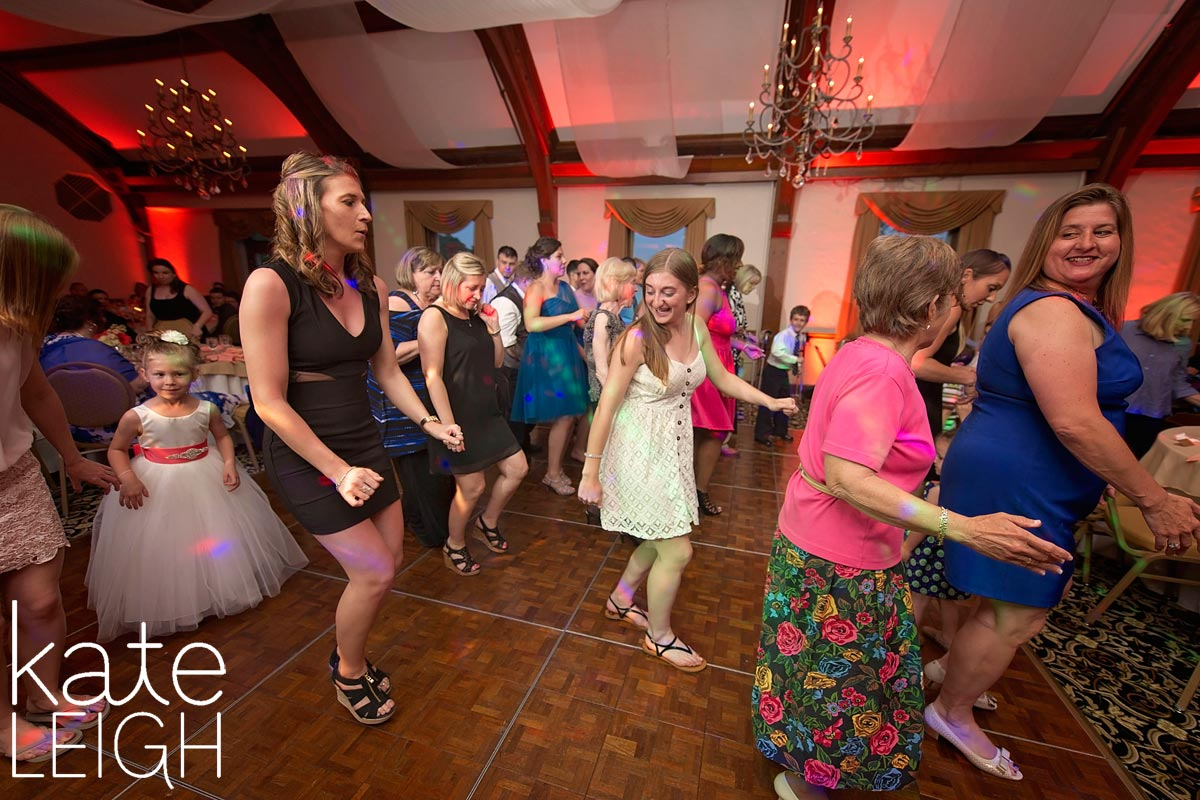 Wedding guests dancing to the electric slide