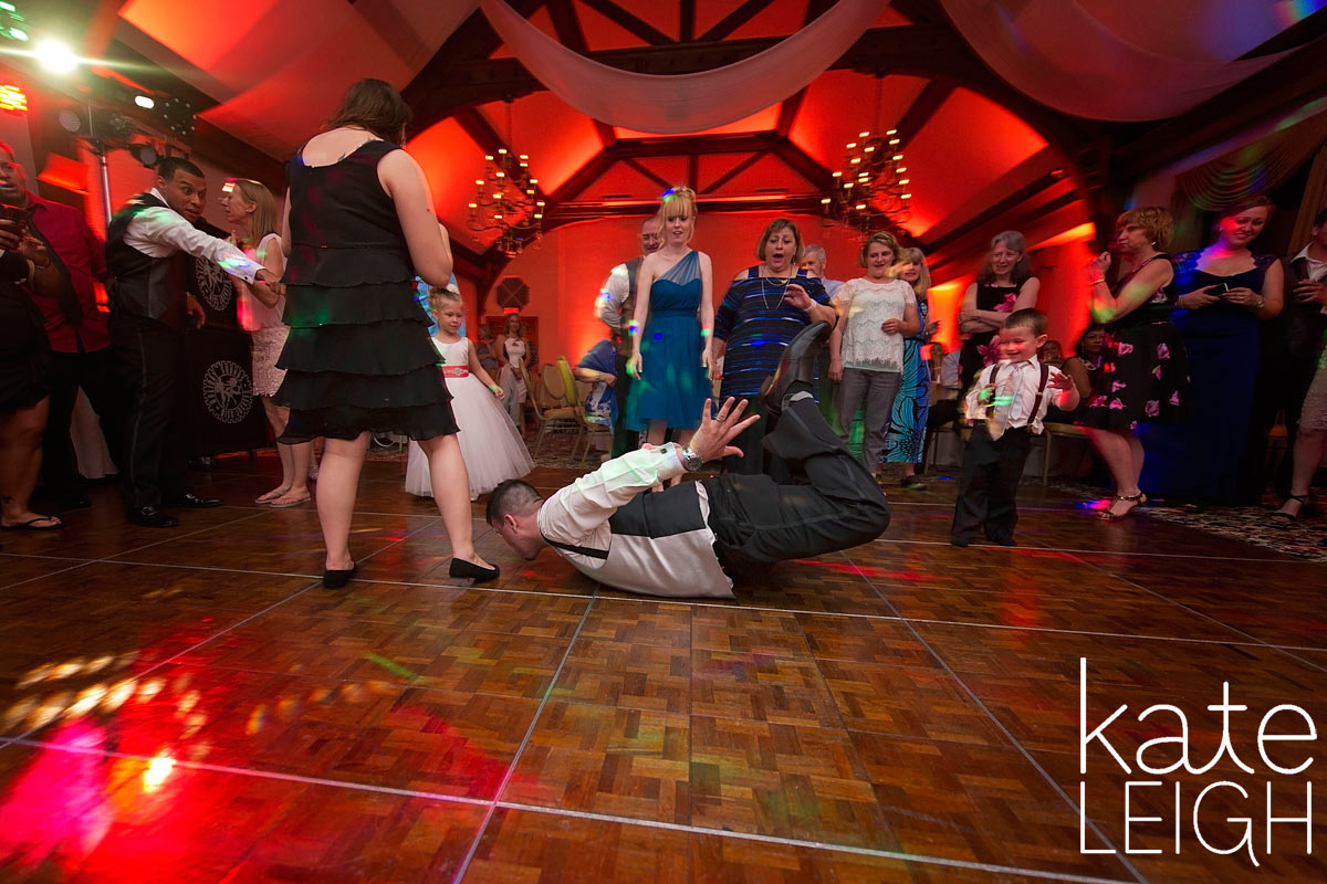 Groom slides across dance floor on chest