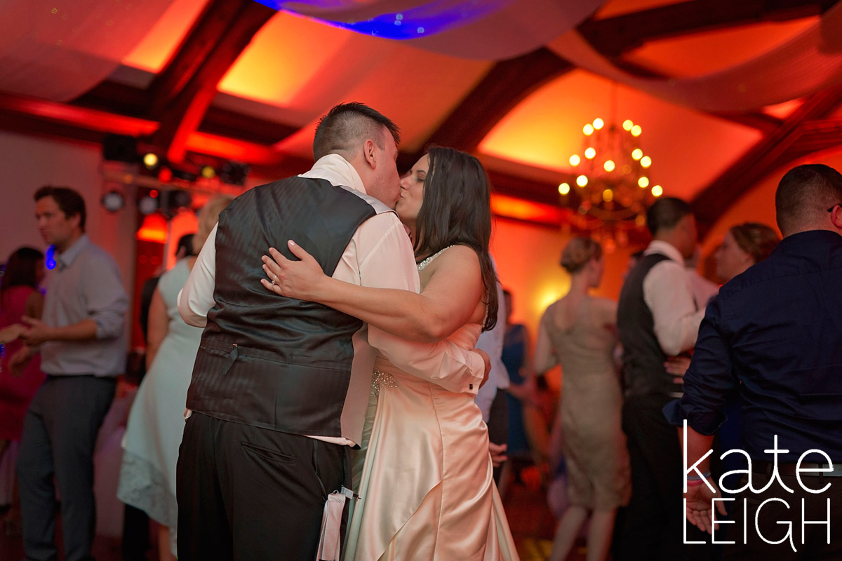 bride and groom share last kiss on the dance floor at their wedding