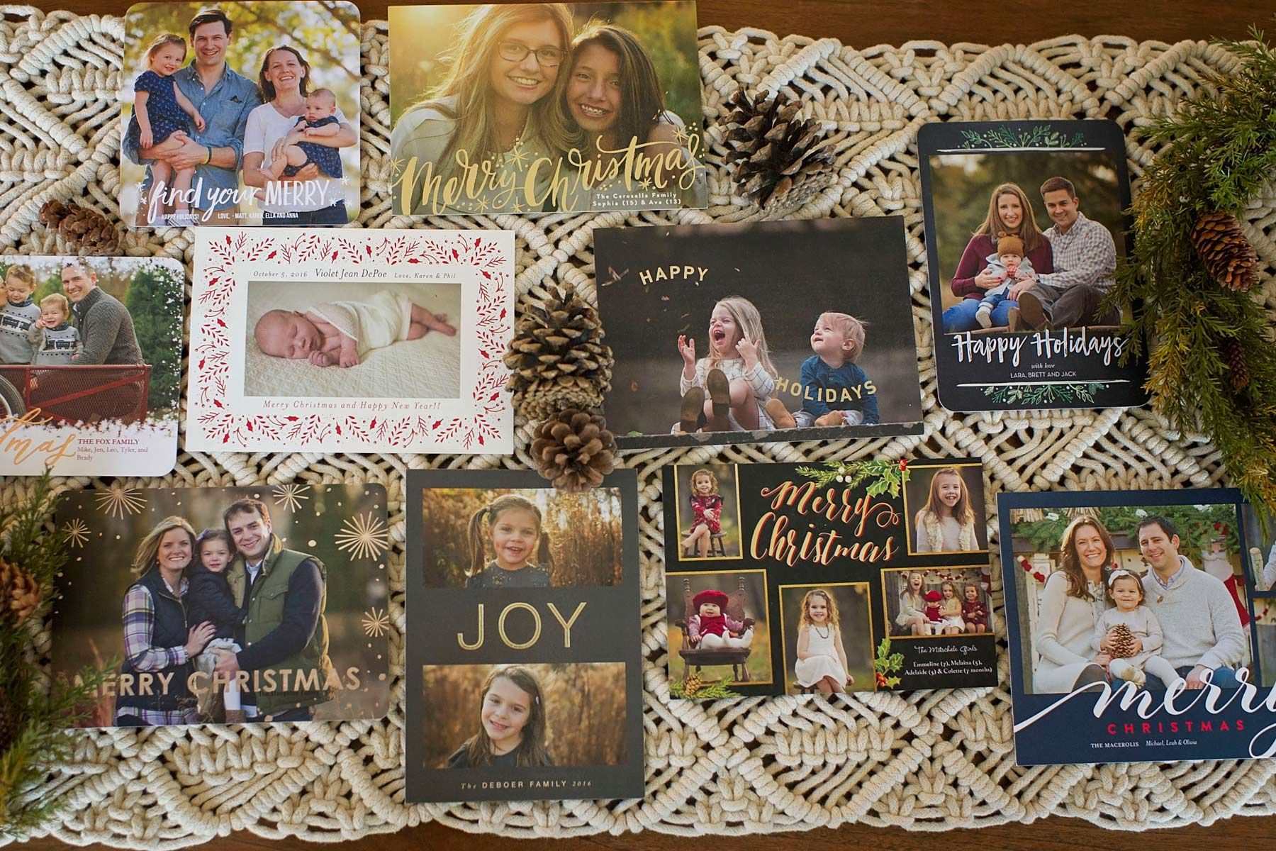 holiday photo cards arranged on a table