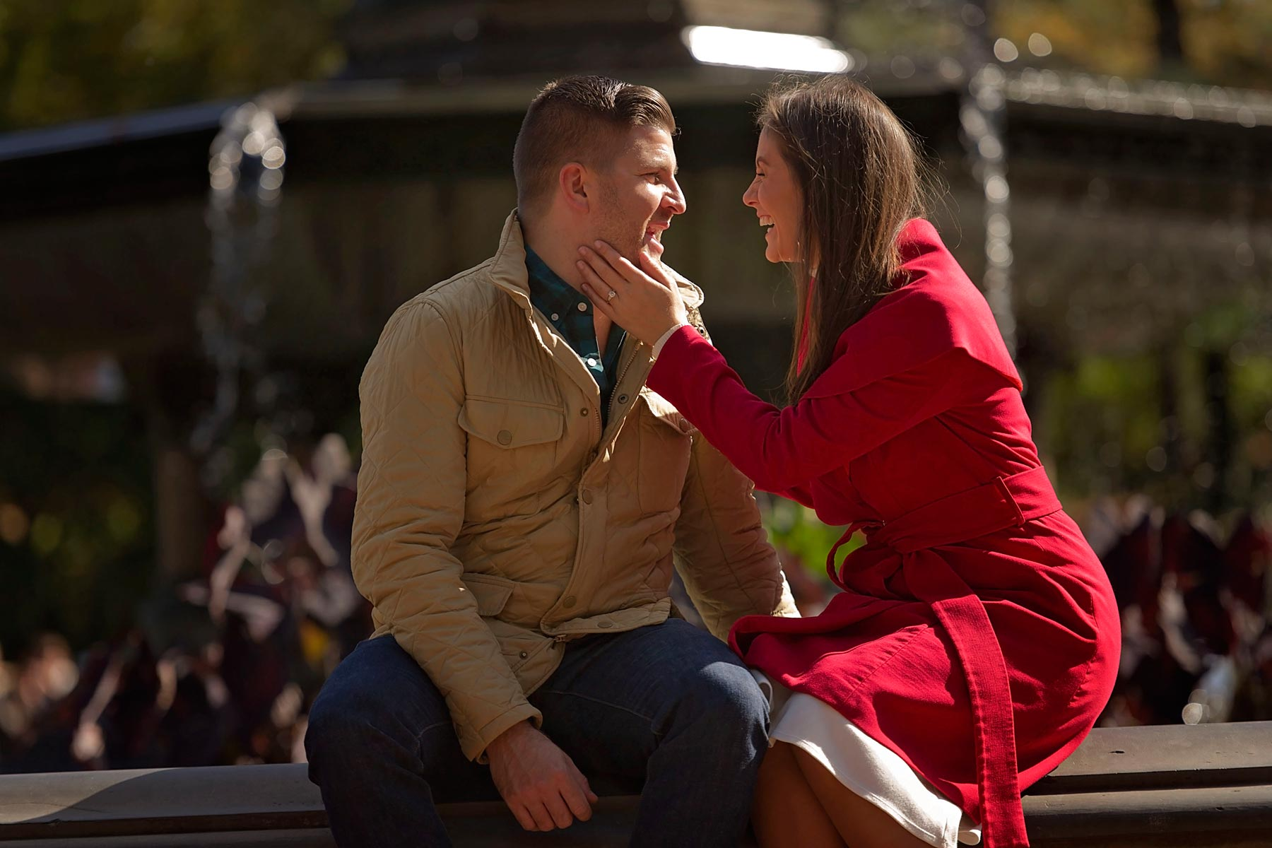 engaged couple laughing by Bethesda fountain in central park