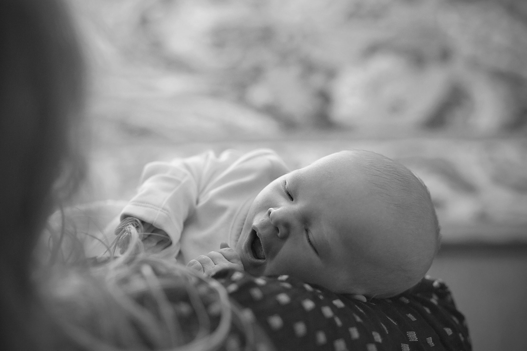 black and white of newborn baby yawning