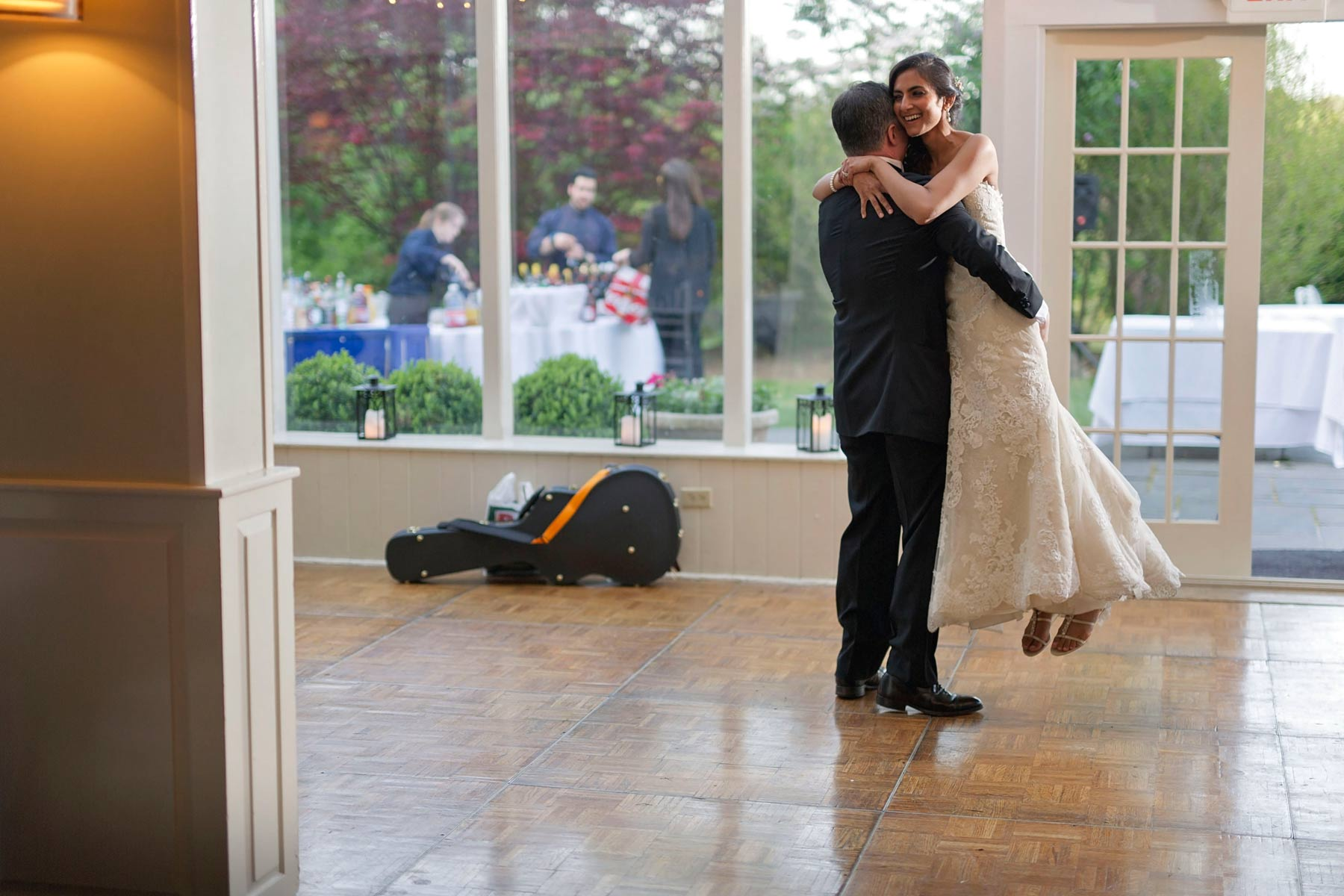 groom picks up bride at the end of first dance