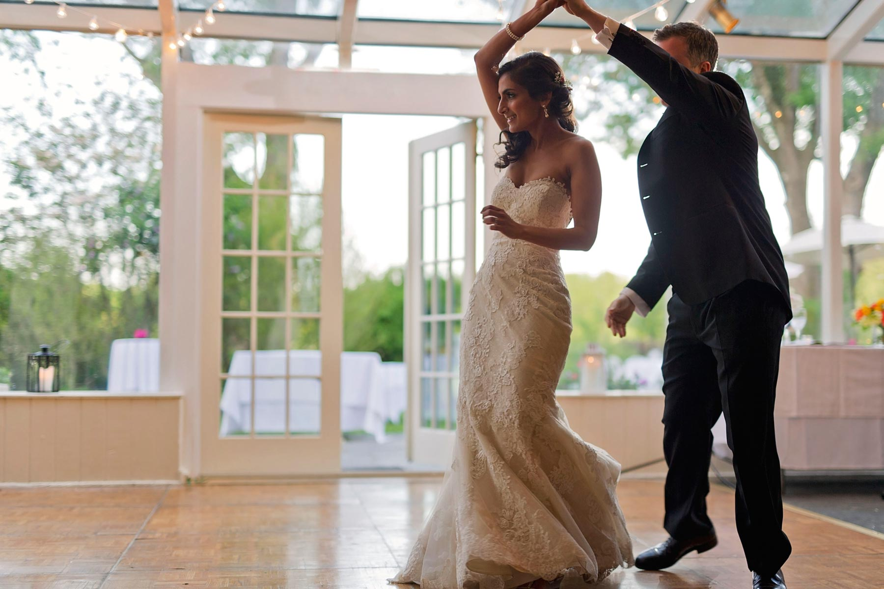 groom twirls bride during first dance