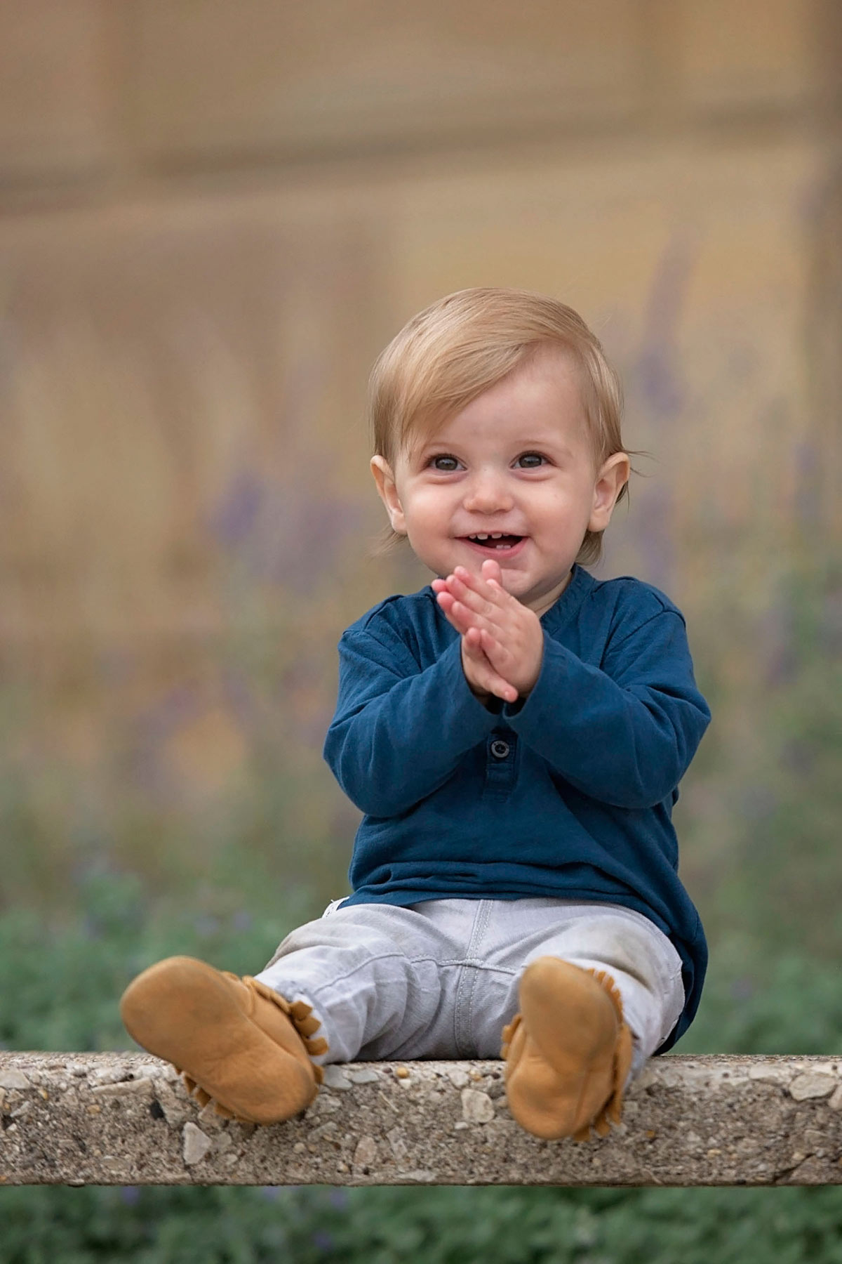 one year old boy laughing and clapping his hands