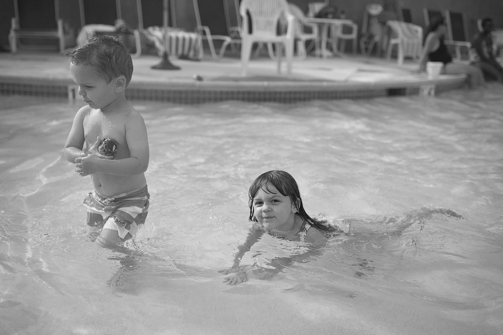 black and white of two kids in the baby pool
