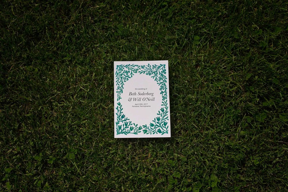 invitation laying in the grass