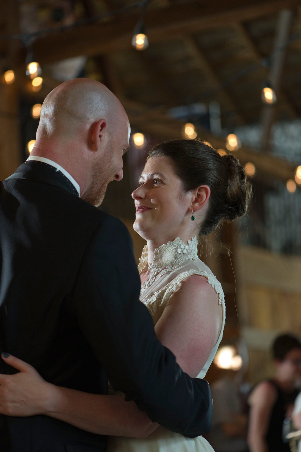 bride and groom share their first dance in the barn at stonebrook