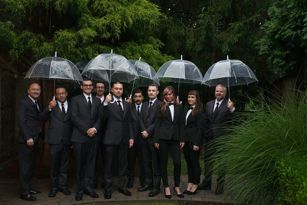Bucks_County_wedding_photographer_Stroudsmoor_country_inn_wedding_Philadelphia_wedding_photographer_10_wedding_party_clear_umbrellas.JPG