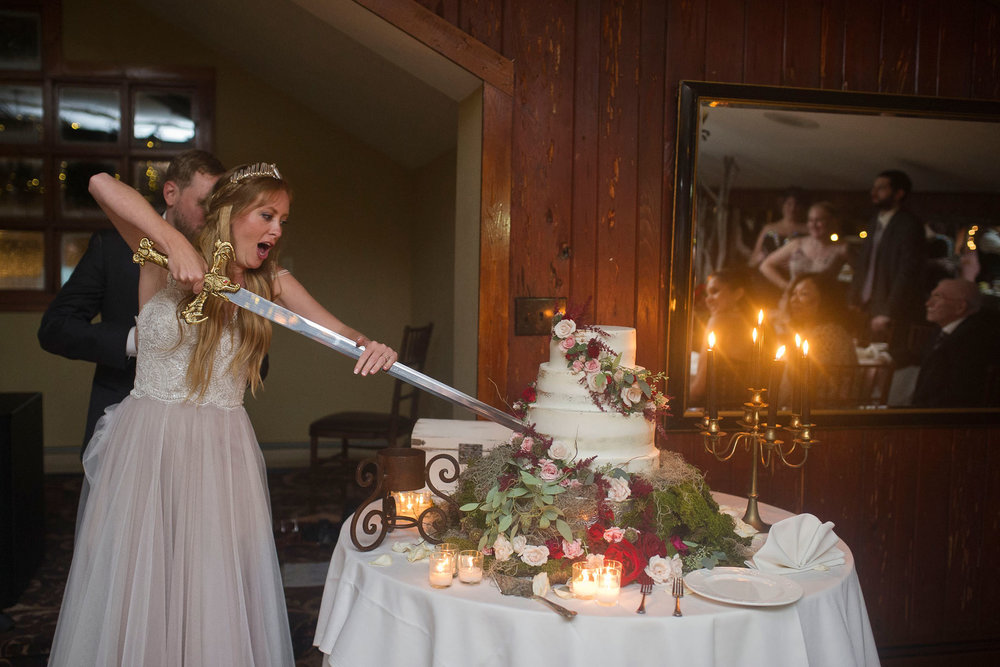 Bucks_County_wedding_photographer_Stroudsmoor_country_inn_wedding_Philadelphia_wedding_photographer_31_sword_cake_cutting_game_of_thrones_wedding.JPG