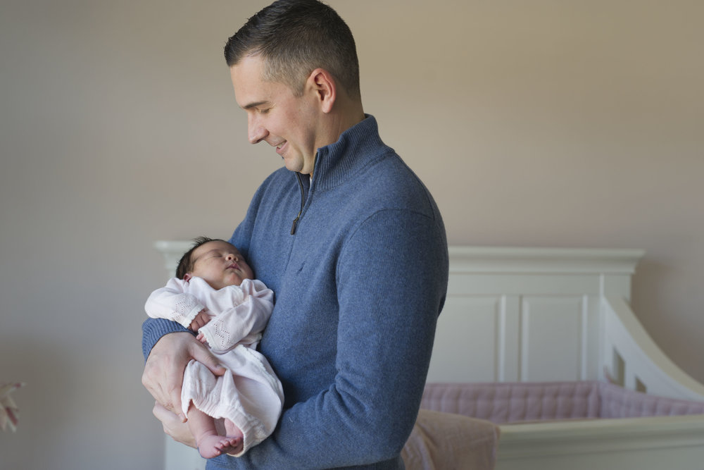 Glen_Mills_newborn_photographer_dad_holding_baby_girl.JPG