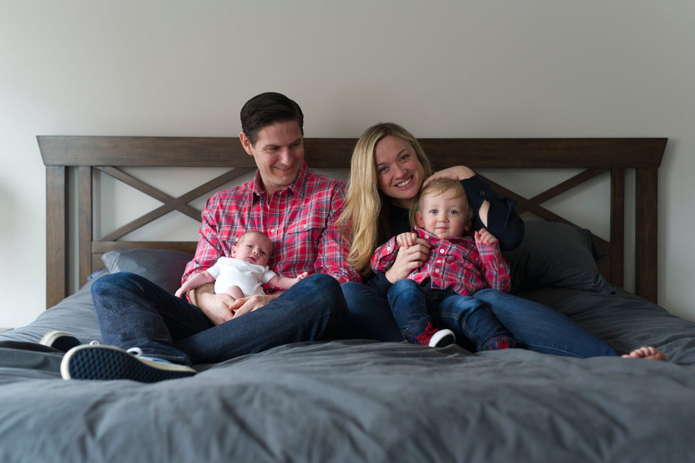 New_family_of_four_on_bed_in_plaid_shirts.jpg