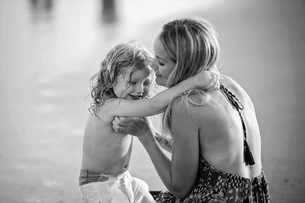 mom_gets_hug_from_son_on_beach_in_ocean_city_NJ.jpg