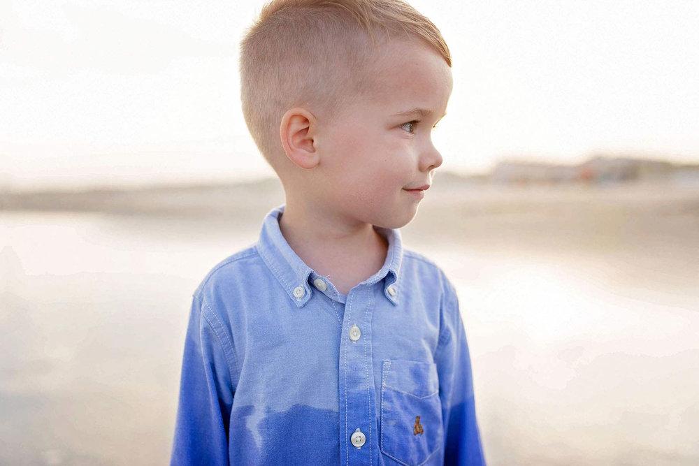little_boy_at_sunset_on_beach_in_ocnj.jpg