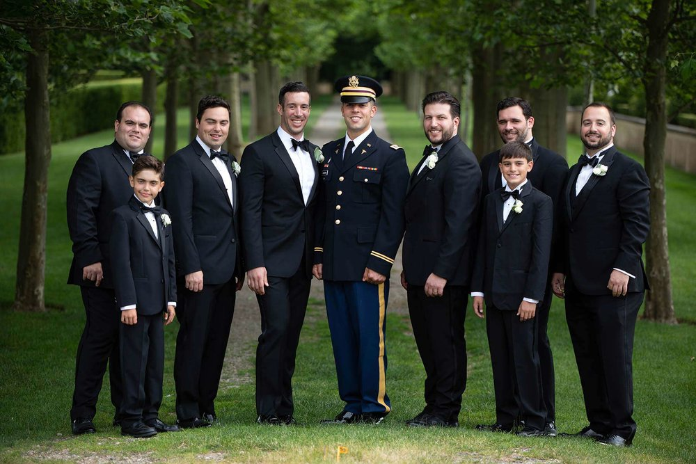 16_Groomsmen_pose_outside_Oheka_Castle.jpg