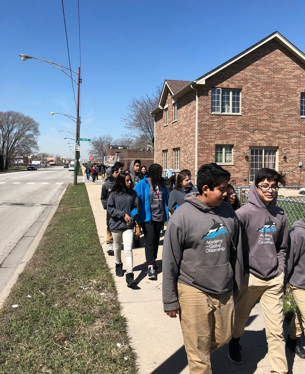 Students participate in an observational neighborhood walk.