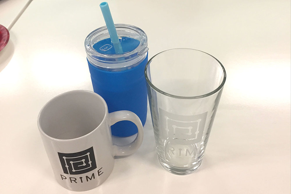 The water bottle that I performed a Usability Test on, next to the ubiquitous Prime mug and glass.