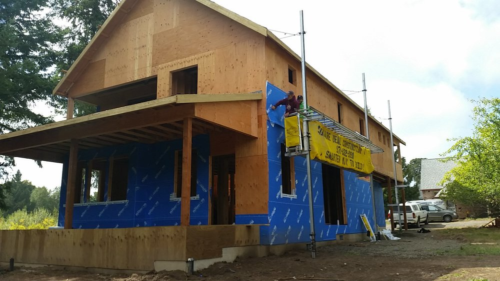 We are finally onto the housewrap phase. (And just in time for the rainy season!)