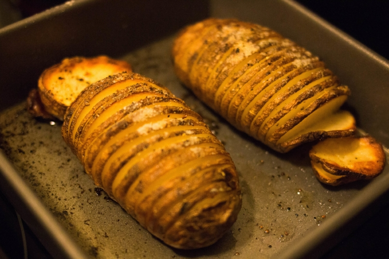 Hasselbeck potatoes, sliced, seasoned with slices of butter and generous amounts of sea salt and freshly ground pepper, roasted at 450-degree oven for an hour. And honestly, how clucky are these potatoes?
