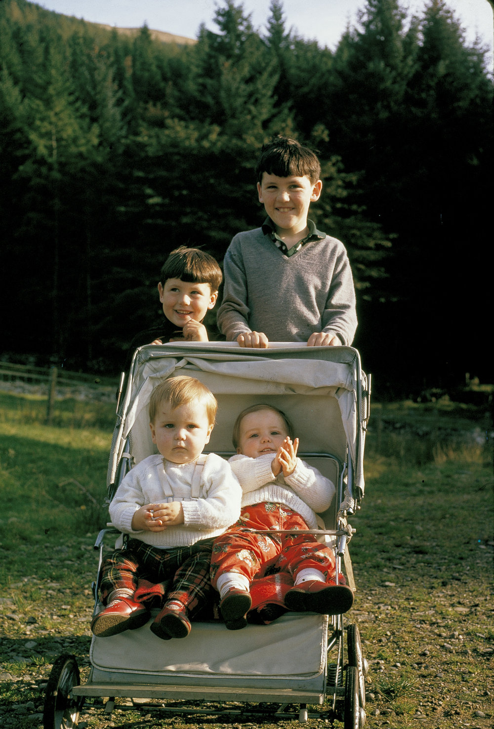 Gavin and his Brothers on the farm in Scotland. Gavin is one of the twins in the buggy.