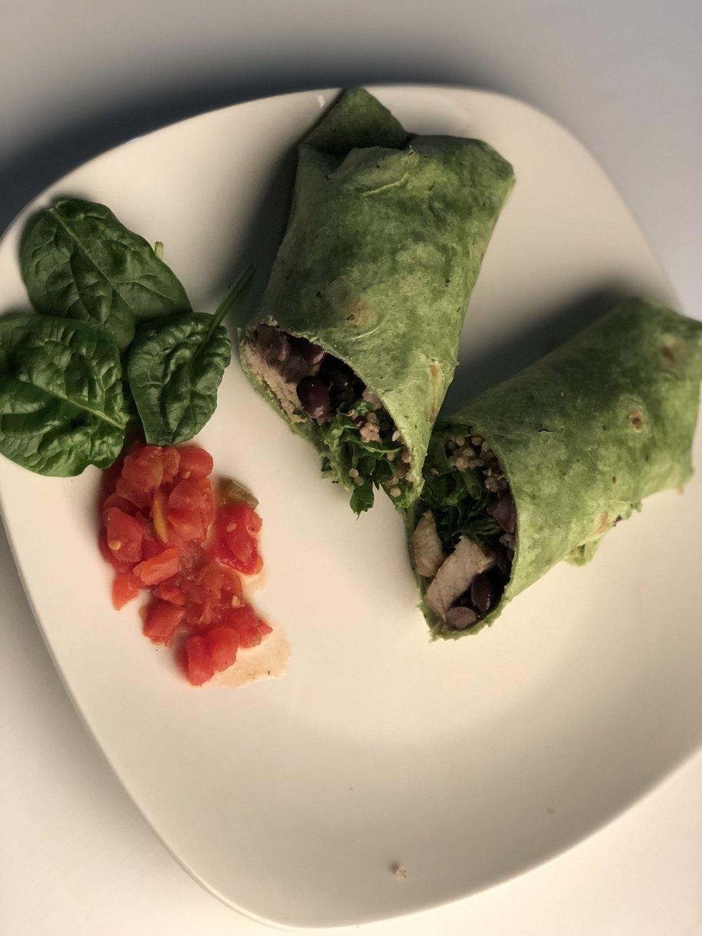 Green Spinach Chicken Wrap   Spinach wrap, black neans, chicken, quinoa/brown rice, plain greek yogurt, spicy habanera dip