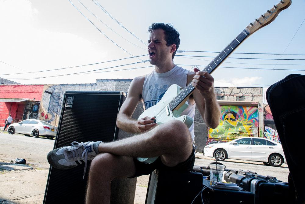 Jon Mann sidewalk shredding in Brooklyn.