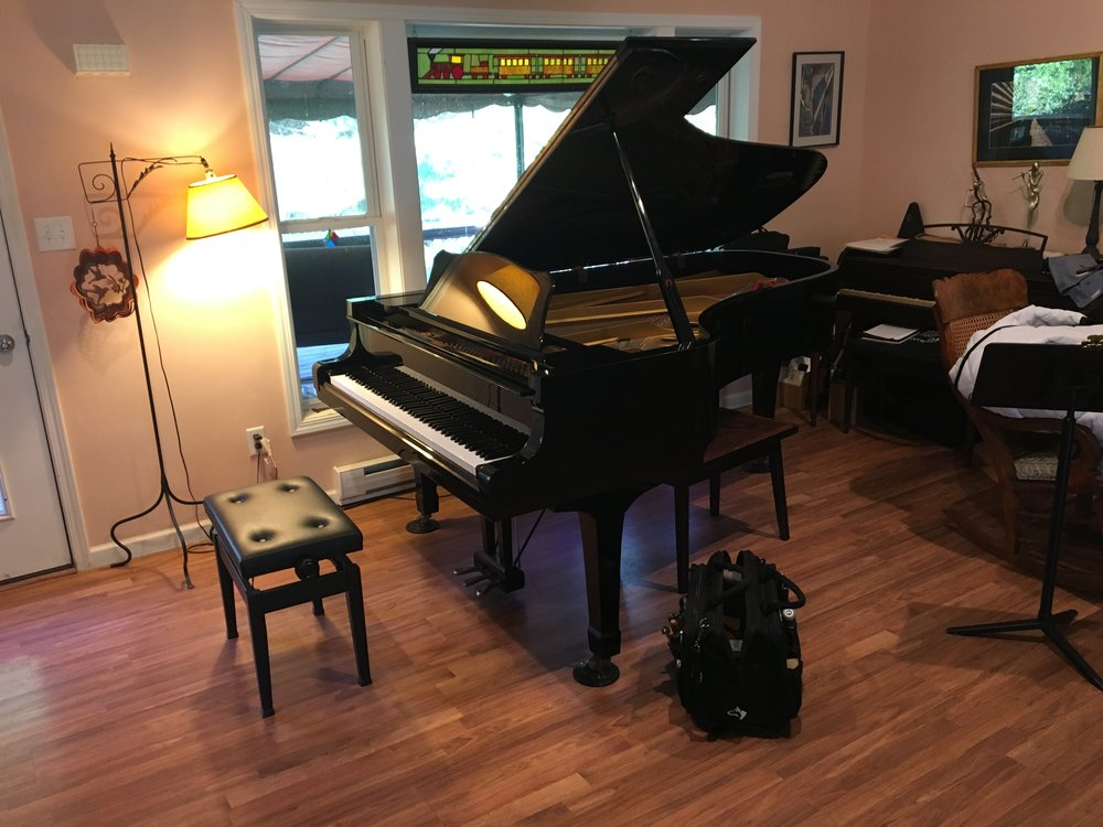 Yamaha C7 with a rebuilt action is prepared for an in-home concert.