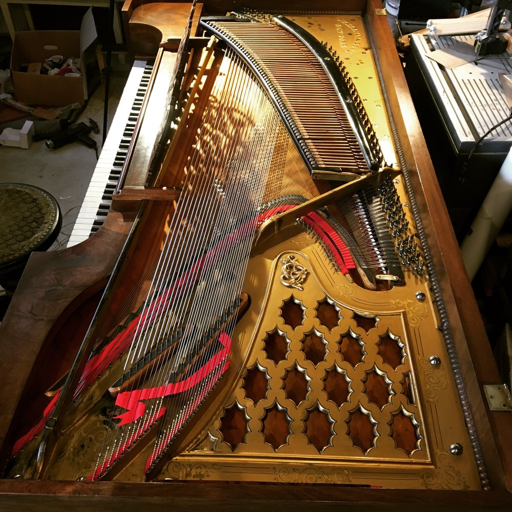 All new strings, tuning pins, hammers, and moderators installed on an 1869 Steinway square grand.  These iron wound bass strings and the rescaled tenor and treble preserve the original tonal quality of this beautiful antique.