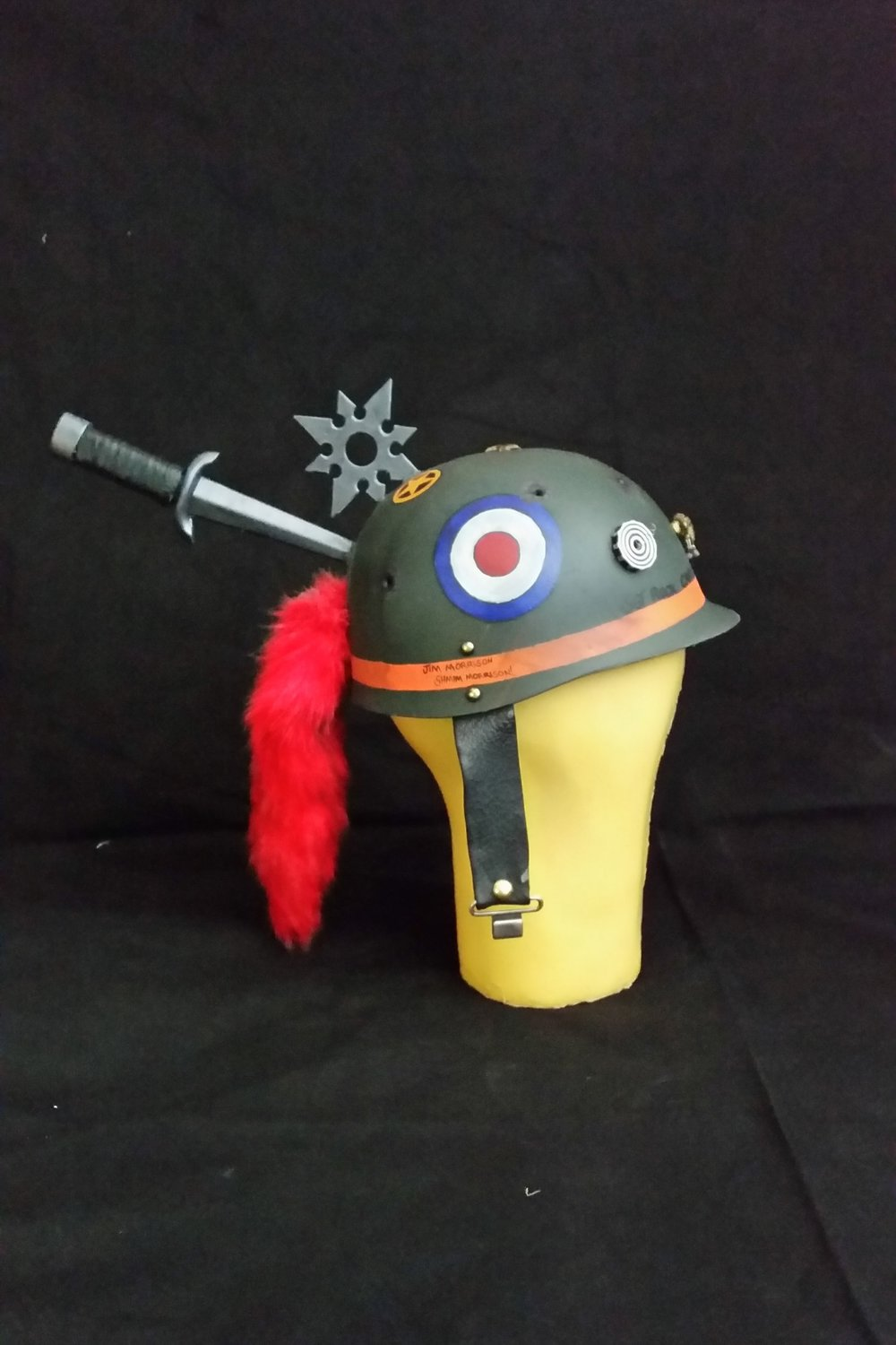 Tank Girl Cosplay, 2016  Personal Project for SDCC  Helmet made from plastic toy helmet, toy weapons, faux tail key chain, leather straps, and acrylic paint