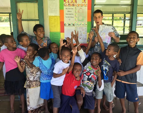 Volunteer teacher Max and his class overseas in Fiji
