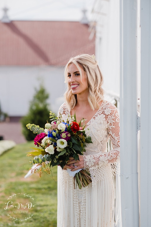 Carly F. September 2016 Barn Wedding Love Me Do Photography (bride w. bouquet)_(1).jpg