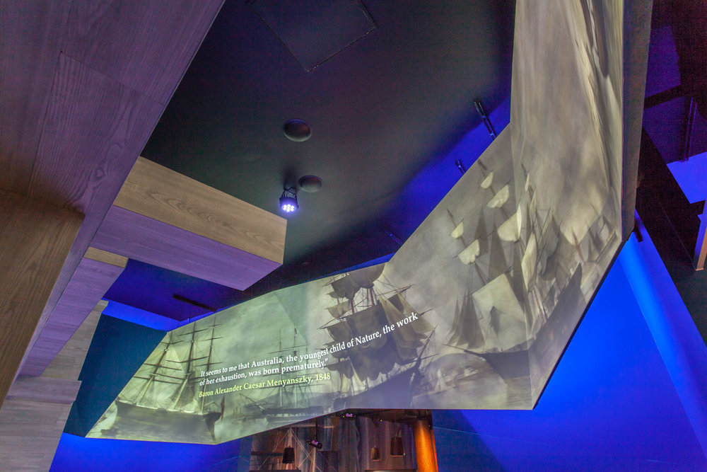 A projection mapped pelmet screen that the audience walked under.