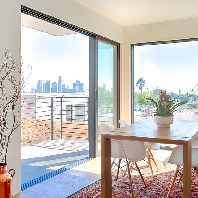 Flashback to this view from Waterloo.  Designed and Built by @new_utopia_design  Styled by @carley_montgomery  Photo by @ericcharlesphoto . . . #designinspiration #ilovela #downtownview #newutopiadesignbuild #midcenturymodern #design #houzz #modernhome #apartmenttherapy