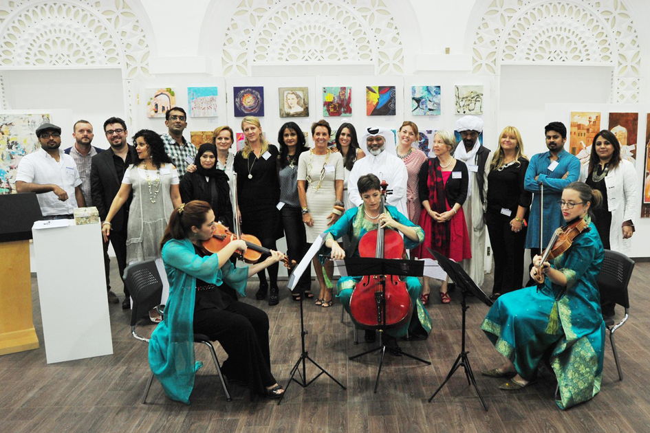 group photo of the International Artists Doha at the opening of the group exhibition in 2014