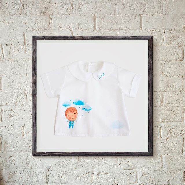 This framed hand painted shirt can be a sweet decoration for a baby room's wall. #lescherubins #lescherubinsart #lescherubinsbydominika #handpaintedshirt #handpaintedbabyclothes #christeninggift #baptismgift