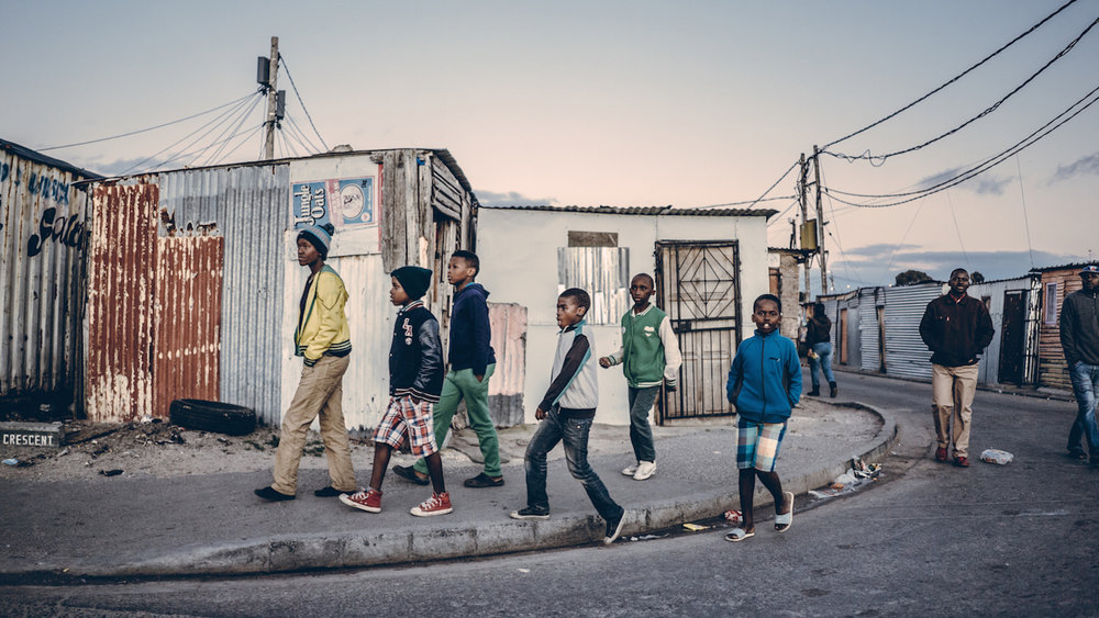 boys-walking-down-the-street-piotr-south-african-township-1.jpg