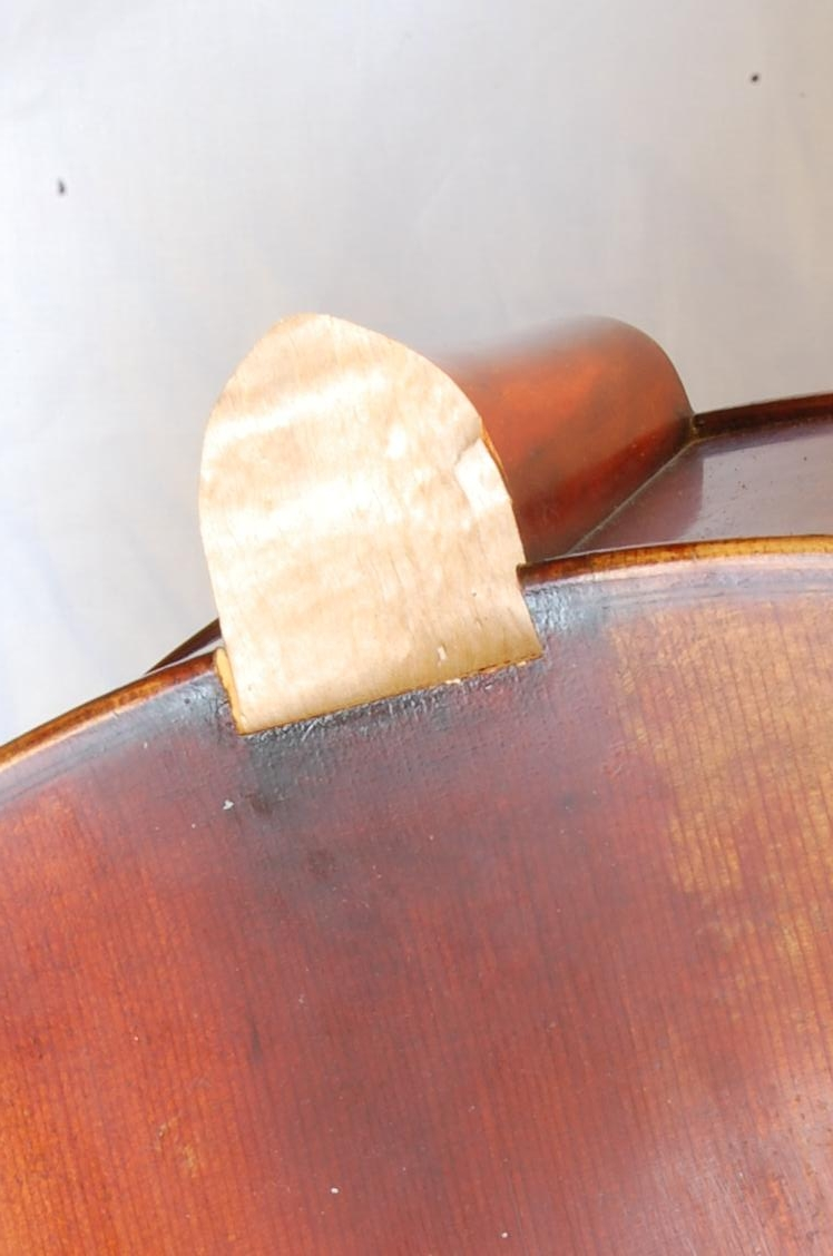 Above is a cello with a snapped neck, below a step by step repair.