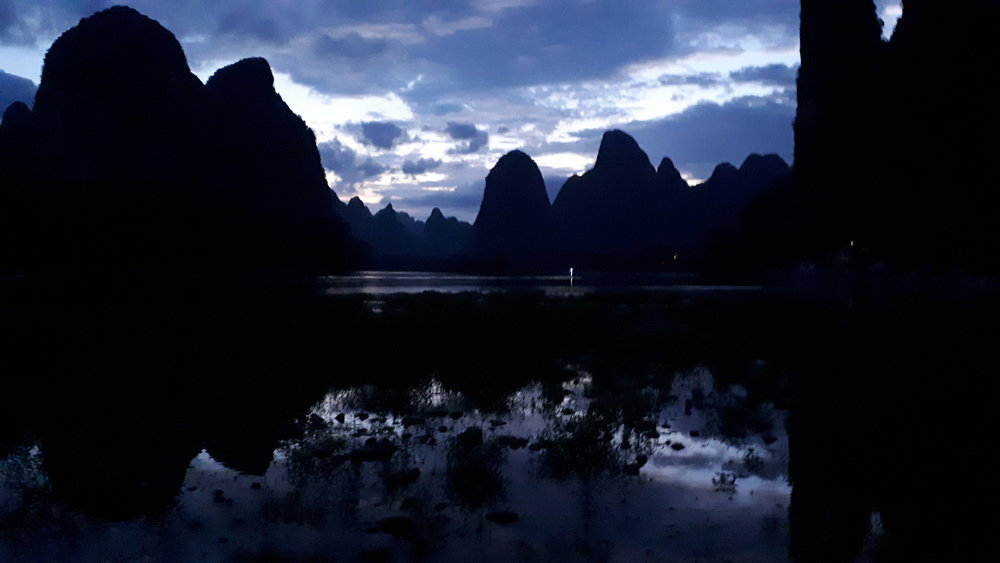 Blue hour light silhouetting the karst limestone mountains