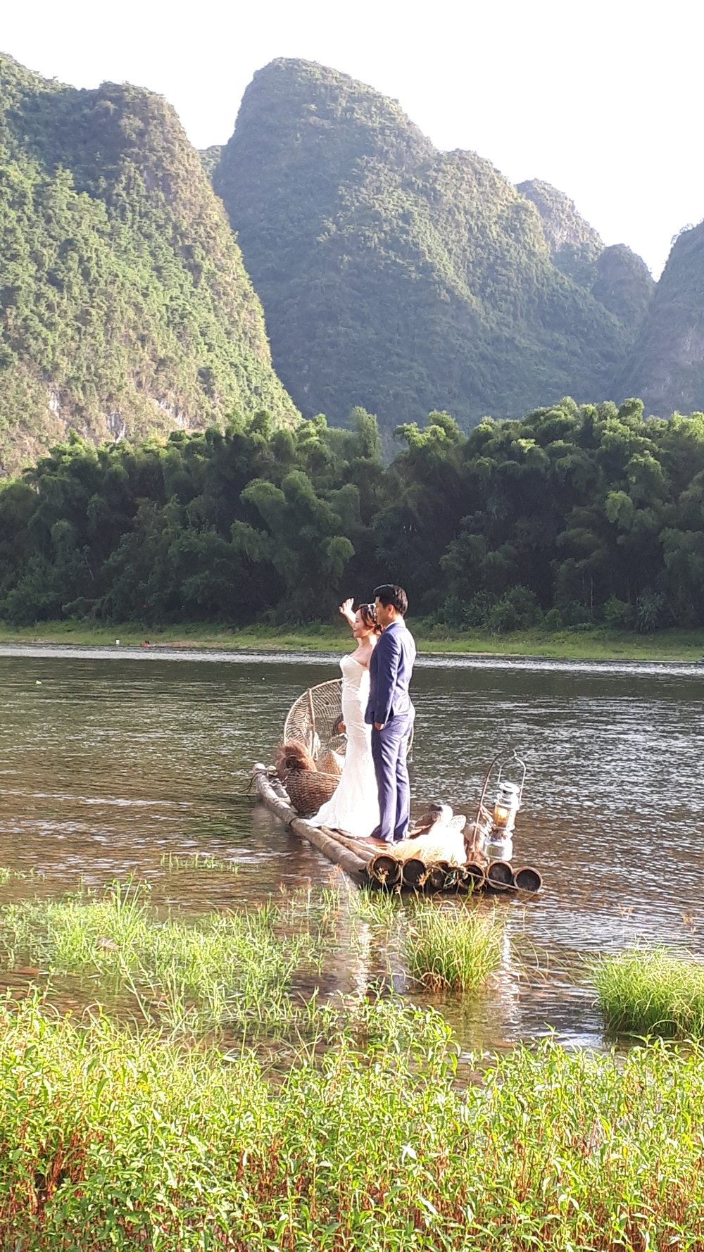 Weding photos being taken on a bamboo raft on the Lijiang River.