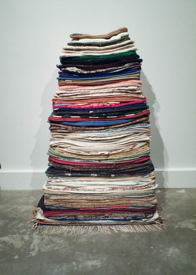 Leaning Stack, cut pillow cases, gallery wall.  2012