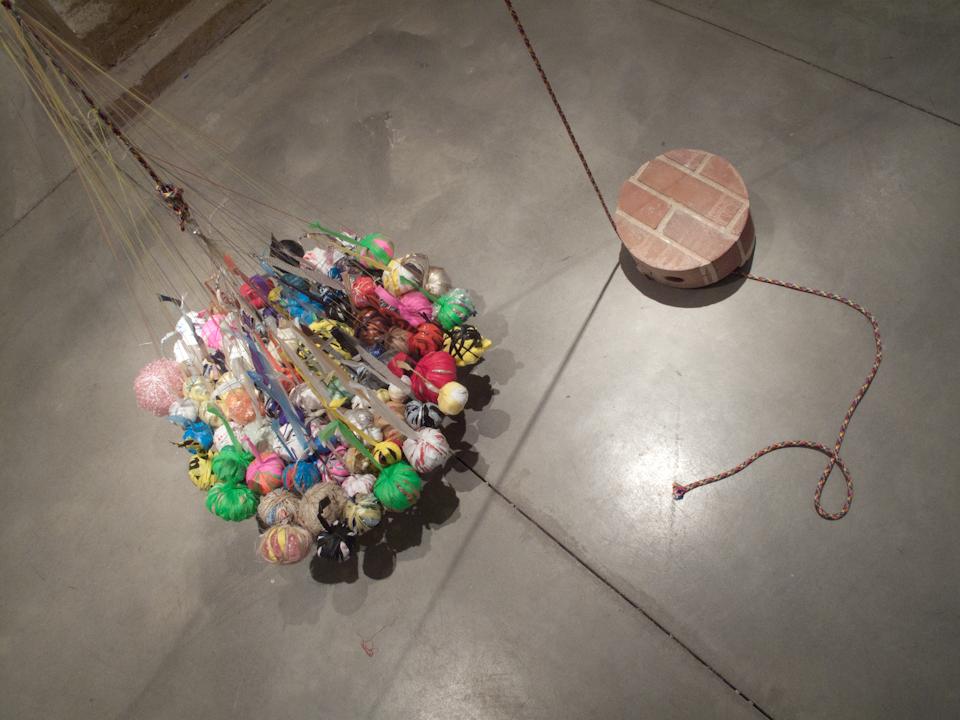 Balancing Wall, plastic bags, rope, brick wall segment. 2012