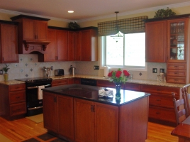 Omega Dynasty Heritage door style - Cherry wood - Nutmeg stain - Santa Cecelia granite w/Absolute Black on Island