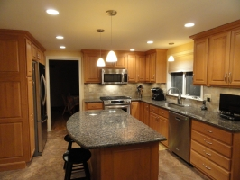 Omega Dynasty - Wellington Square - Alder wood - Honey stain - Autumn Brown Granite Countertops