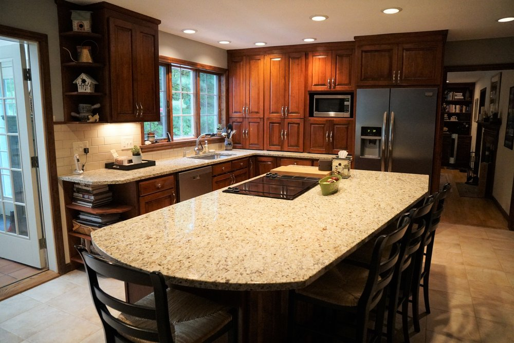Countertop replacement from laminate and tile to Giallo Ornamental granite