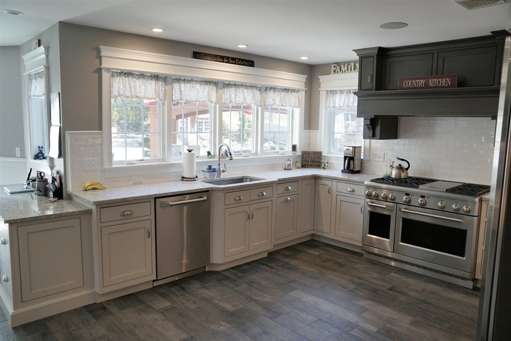 """Omega Custom & Dynasty - Puritan Beaded Inset door style - Maple wood with Magnolia opaque finish on bases & Alder wood with Smokey Hills stain on uppers - Cambria Quartz """"New Quay"""" on perimiter and Alaska White Granite on Island and Baking Center"""