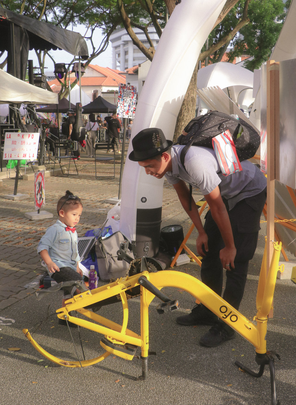 Visitors looking at Trase One's piece, which is mounted onto an O-Bike.