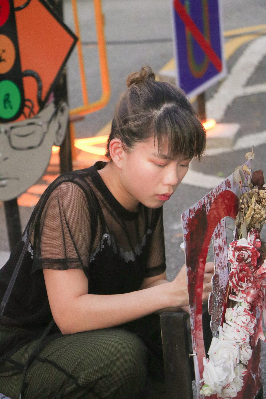 @lifeofapotatodancer adding final touches to her work.
