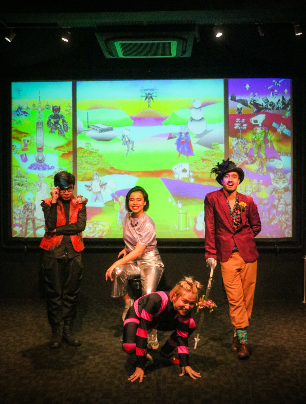 Installation view of The Garden of Internet Delights, with theatre group Patch and Punnet posing in front of Zxerokool's digital artwork.