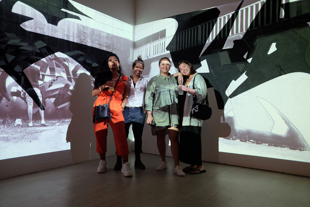 Visitors standing in front of a projection in Nicholas Quek and Chong Wah's 'It Is What It Is'.